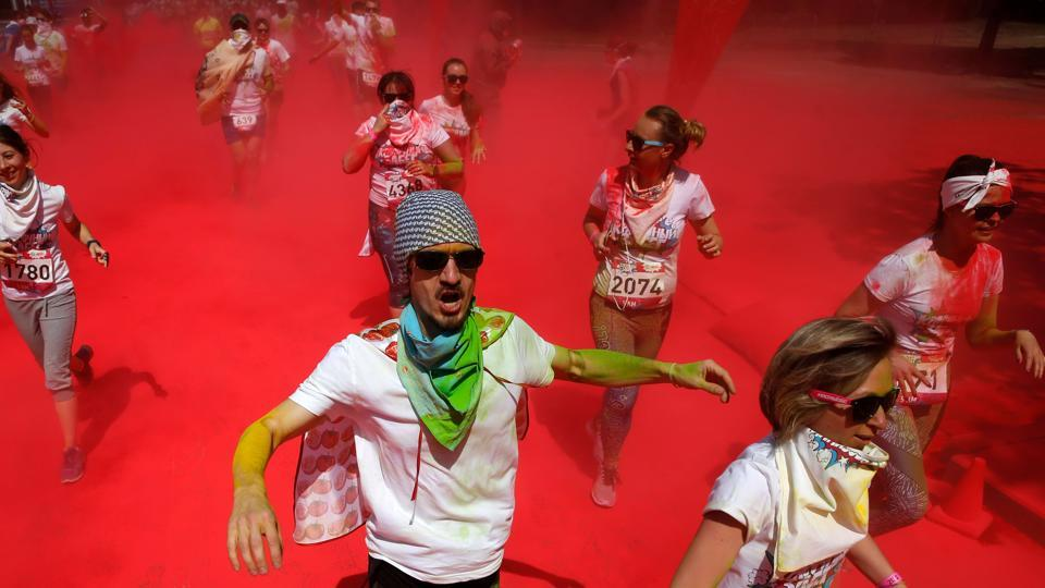 Participants compete  during the Colour Run 2017. The Color  run is an event series and five kilometre paint race that is owned and operated by The Color Run LLC, a for-profit company. (Maxim ZMEYEV / AFP)