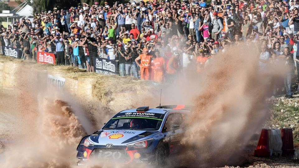 Belgian driver Thierry Neuville and co-driver Nicolas Gilsoul drive their Hyundai i20 Coupe WRC at 'Arena motocross' near Ittiri, during the first stage of the 2017 FIA World Rally Championship in Sardegna. (Andreas SOLARO/ AFP)