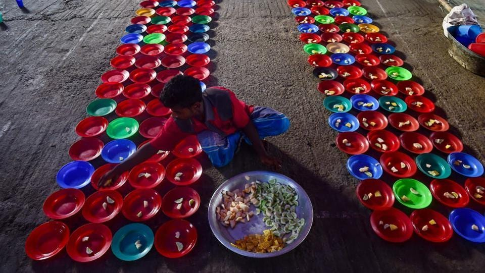 Bangladeshi volunteers prepare plates of Iftar foods for residents to break their fast at a shrine in Dhaka. Muslims throughout the world are marking the month of Ramadan, the holiest month in the Islamic calendar during which Muslims fast from dawn until dusk.