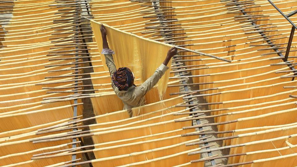 A Pakistani man dries Seviiyan (thin vermicelli), which is used for the preparation of 'sheerkhurma', a traditional sweet dish prepared by the Muslim community during the holy month of Ramadan, at a factory in Lahore. (ARIF ALI / AFP)