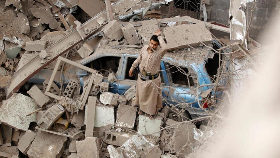 A Yemeni man reacts on the rubble of houses destroyed in a suspected Saudi-led coalition air strike in Sanaa. Four civilians, including two teenagers, died 'in a strike by the coalition that targeted a civilian house behind the presidential palace in the south of the capital', a medical source said. (MOHAMMED HUWAIS / AFP)