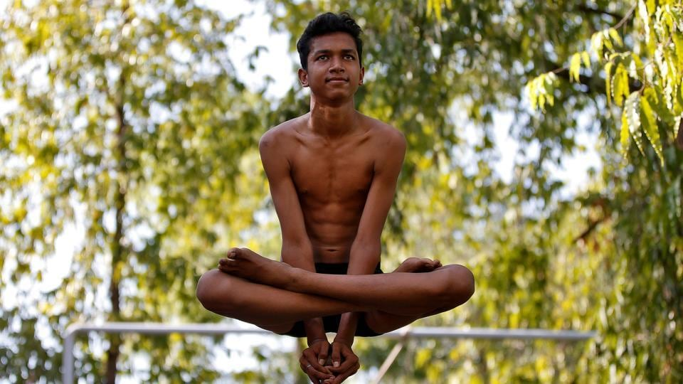 A performer practices 'Mallakamb ' (traditional Indian gymnastics) during a rehearsal for the upcoming annual Rath Yatra, or chariot procession, in Ahmedabad, India. (Amit Dave  / REUTERS)