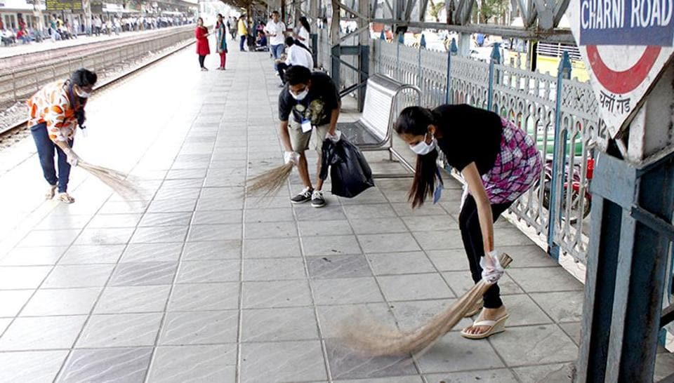 College students clean a station as part of the Swachh Bharat campaign in Mumbai.