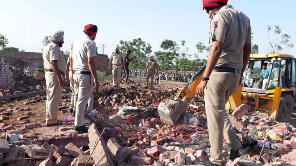 Police officials conducting the rescue operation in Sunam on Monday.