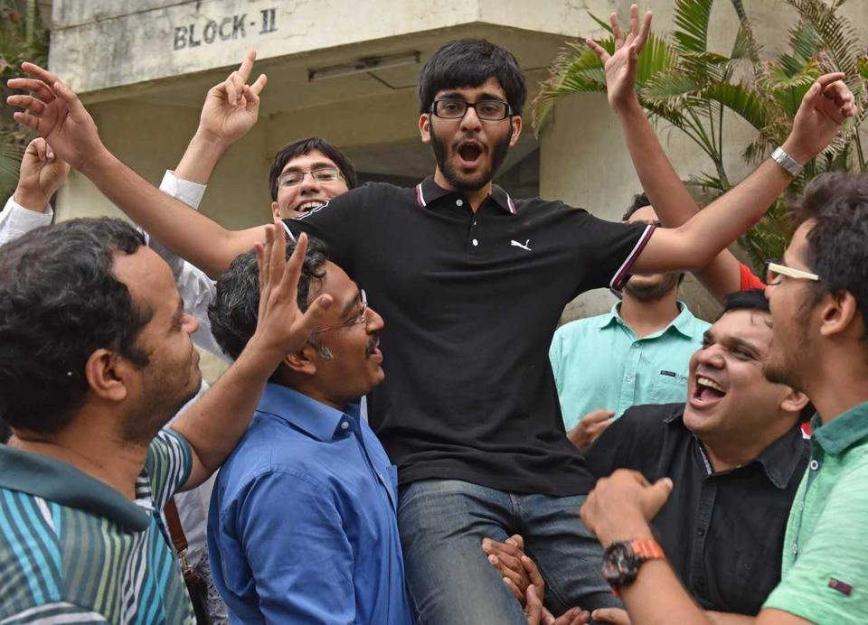IIT JEE topper from Pune Akshay Chugh celebrates with friends.