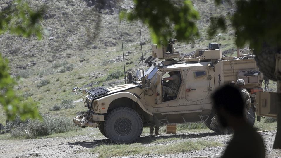 US forces and Afghan commandos patrol in Asad Khil village in the Achin district of Jalalabad.