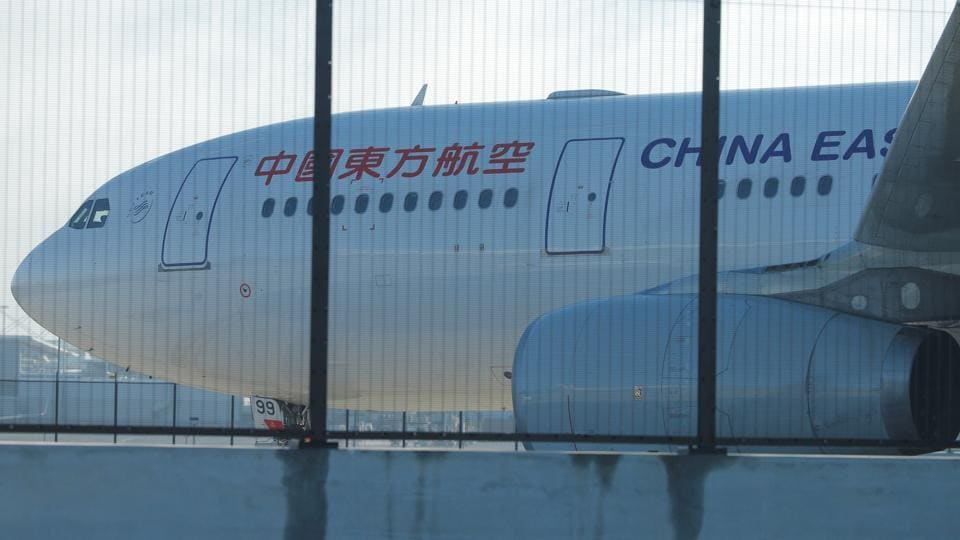 A China Eastern Airlines Airbus A330 aircraft sits on the tarmac at Sydney International Airport in Australia, June 12, 2017, after it made an emergency landing with a damaged left engine.