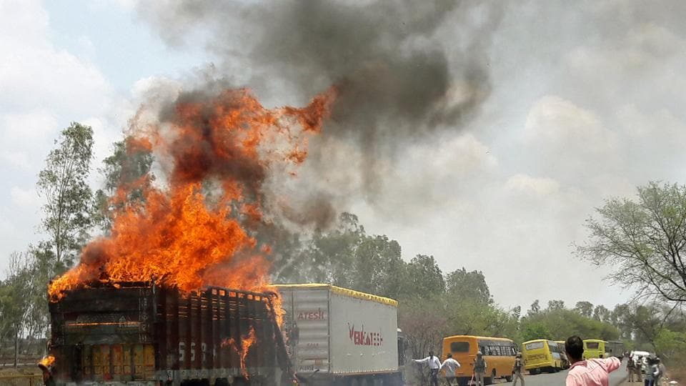 A truck burns during a farmers protest on a highway near Bhopal .