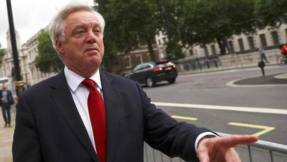 Britain's secretary of state for Brexit David Davis walks out of the Cabinet office in Westminster, central London.