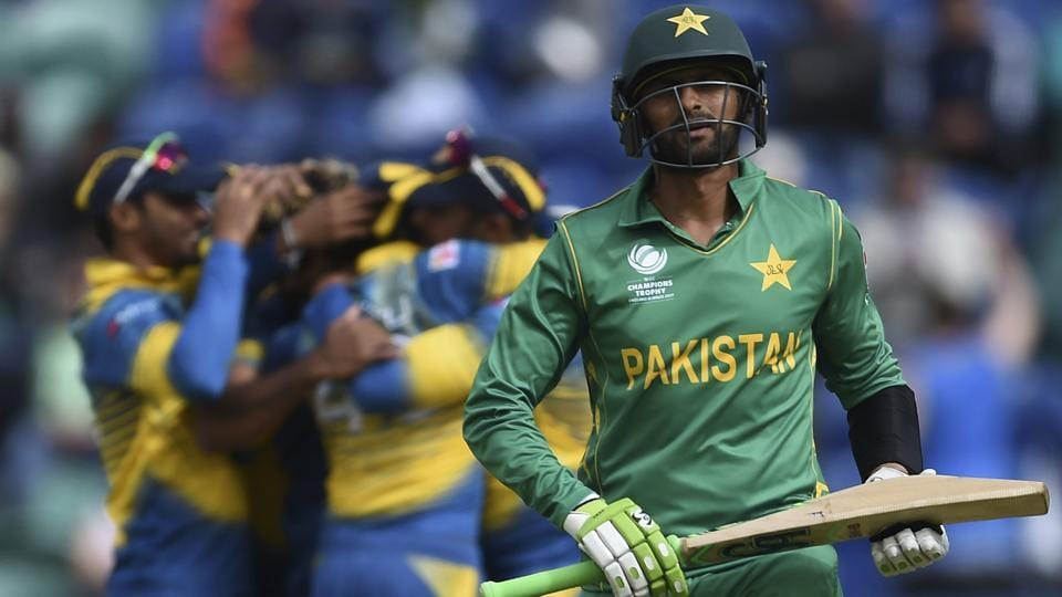 Pakistan's Shoaib Malik leaves the field dejected against Sri Lanka. (AP)