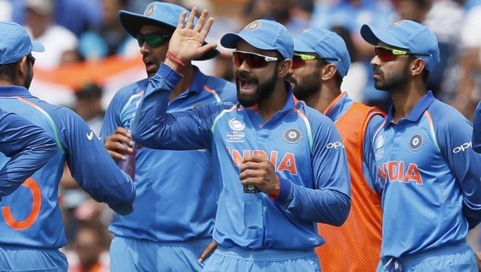 Virat Kohli (C) celebrates with teammates a South Africa dismissal in their ICC Champions Trophy match on Sunday.