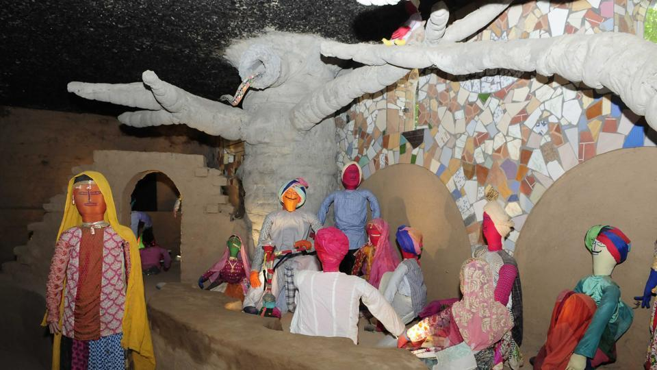Around 200 dolls made from waste clothes, special huts and trees give a countryside feeling. (Keshav Singh/HT Photo)