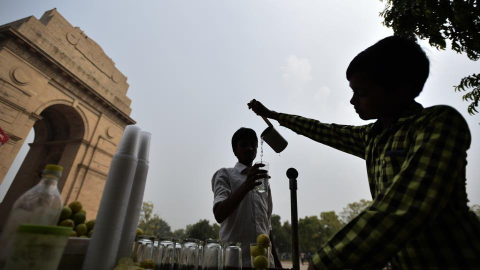 An 11-year-old boy sells lemonade near  India Gate, in New Delhi. According to the UNICEF, there are approximately more than 28 million children under the age of 14  working as child labourers in India. Child labor is widely prevalent in India despite laws that seek to keep children in school. These laws are regularly flouted as large numbers of children are forced into difficult and dangerous jobs.  (Burhaan Kinu/HT PHOTO)