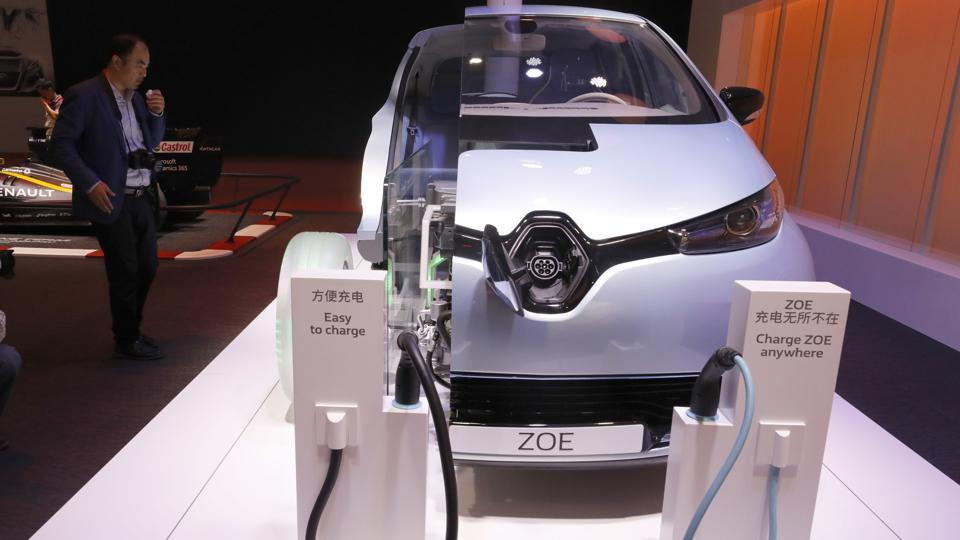 A visitor look at a concept electric car system called the ZOE at the Renault stand during the Auto Shanghai 2017 show at the National Exhibition and Convention Center in Shanghai, China.