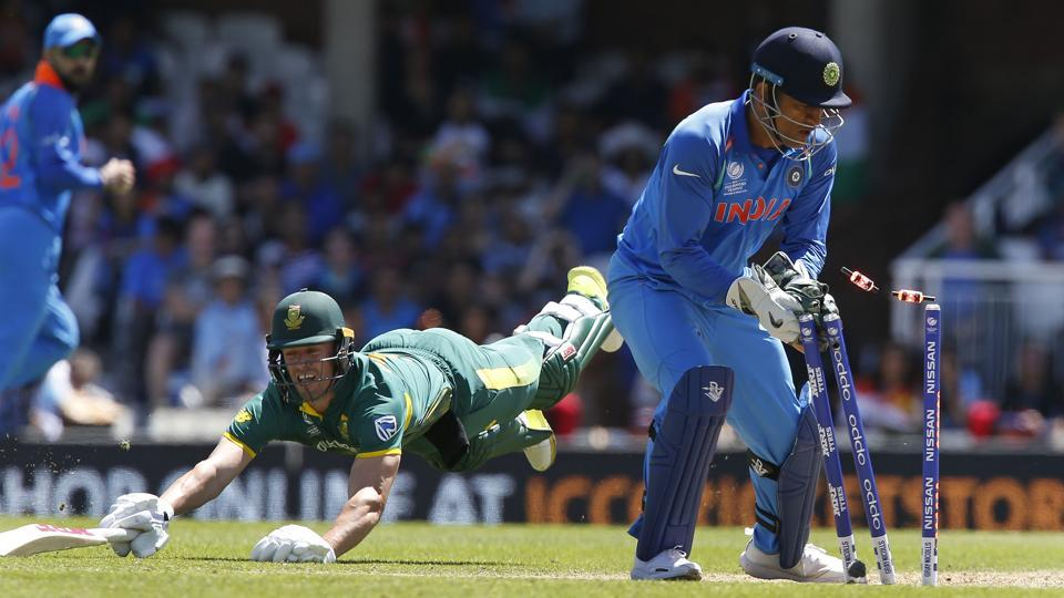 South Africa cricket team's AB de Villiers (left) is run out by India cricket team wicketkeeper MS Dhoni during their ICC Champions Trophy 2017 match at The Oval in London on Sunday.