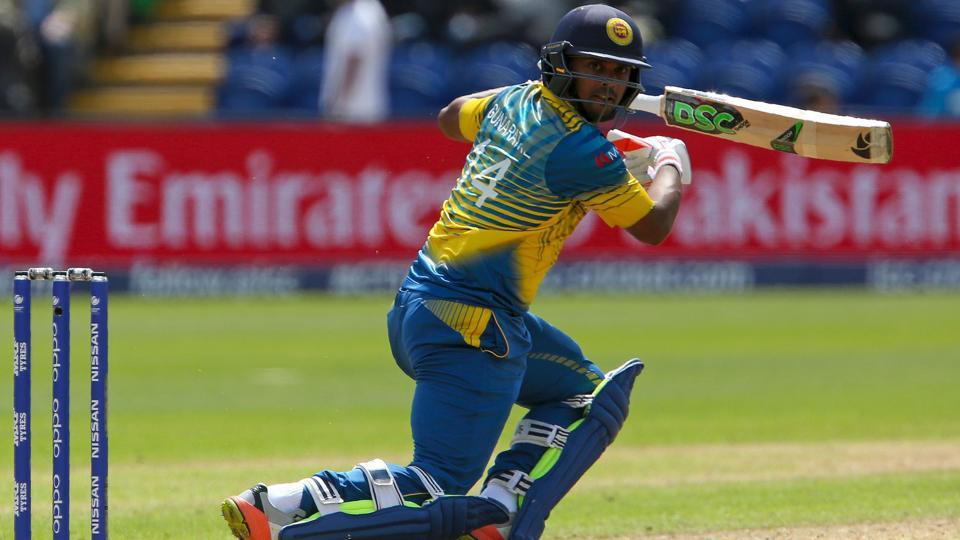 Sri Lanka's Asela Gunaratne watches the ball after playing a shot. (AFP)