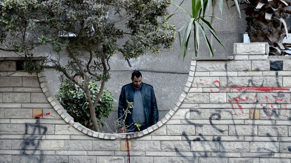 A plainclothes policeman inspects the scene outside a building where an explosion took place in the southern suburb of Maadi in the Egyptian capital Cairo on March 24, 2017. According to a statement by the interior ministry, the blast which was caused by a