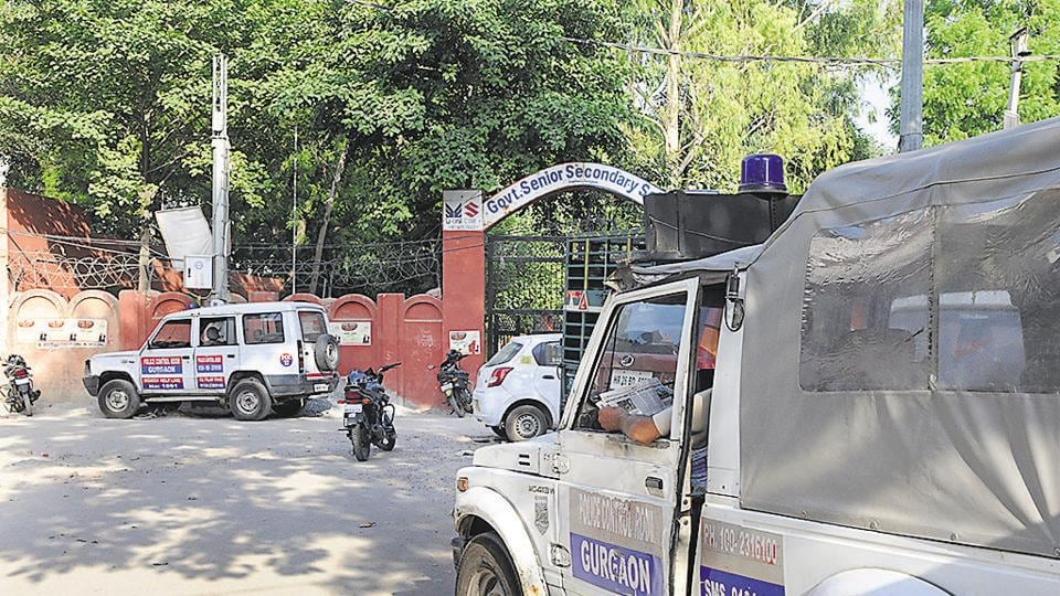 A police jeep stationed  outside the government school in Sirhaul near which the two groups clashed on Sunday evening.