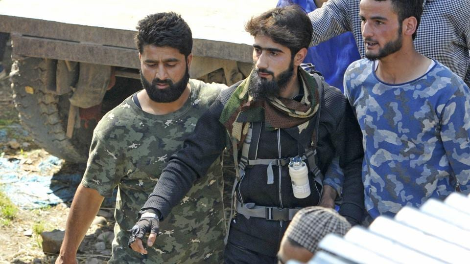 Hizbul Mujahideen militant  Danish Ahmed, seen during the funeral procession of Hizbul commander Sabzar Bhat, at Rathsuna village in Tral in May. He surrendered at a police station in Handwara in Jammu and Kashmir, police said on Wednesday, 7th June. During questioning, Danish revealed that he had been in touch with militants in south Kashmir on social media and was persuaded to join them. (Waseem Andrabi/ht photo)