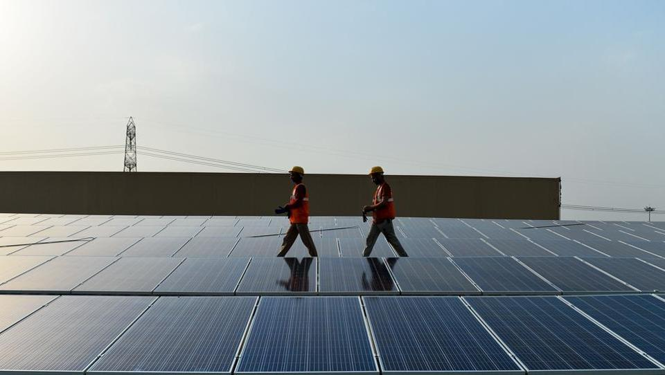 Solar power prices in India have hit rock bottom in the backdrop of fierce pricing competition between Indian and Chinese companies besides others, but it is not all good news for the electricity-starved country as the phenomenon threatens to derail the country's effort to push its green credentials. India is the third largest emitter of greenhouse gases in the world with cities dominating the list of the most polluted on the planet. Not only can renewable energy transform thousands of villages and towns across this vast country, it can put also India on a growth accelerator into the future. (Chandan Khanna/APF)