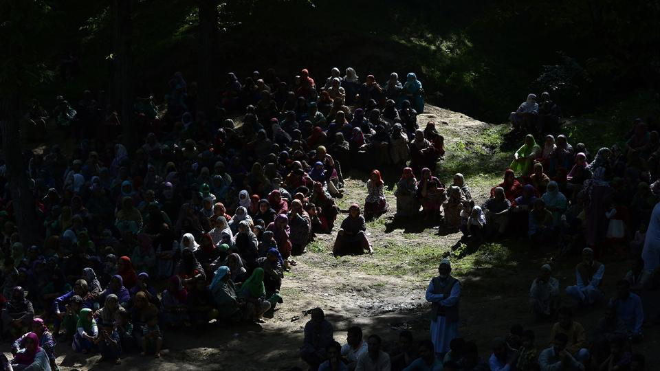 Kashmiri villagers watch the funeral procession of rebel commander Sabzar Ahmad Bhat in Rathsuna Tral, near Srinagar in May, 2017. Authorities imposed a curfew in many parts of the main Srinagar city as violence spread across the restive region after Sabzar Ahmad Bhat's death. (AFP)