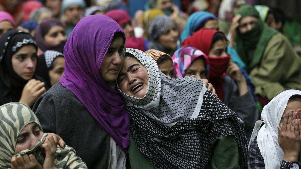 A relative cries near the body of civilian Adil Magray during his funeral at Shopian, about 60 kilometers south of Srinagar on June 7, 2017. Magray, was killed last Tuesday after government forces opened fire on protesters during a search operation to flush out Kashmiri rebels. (AP)