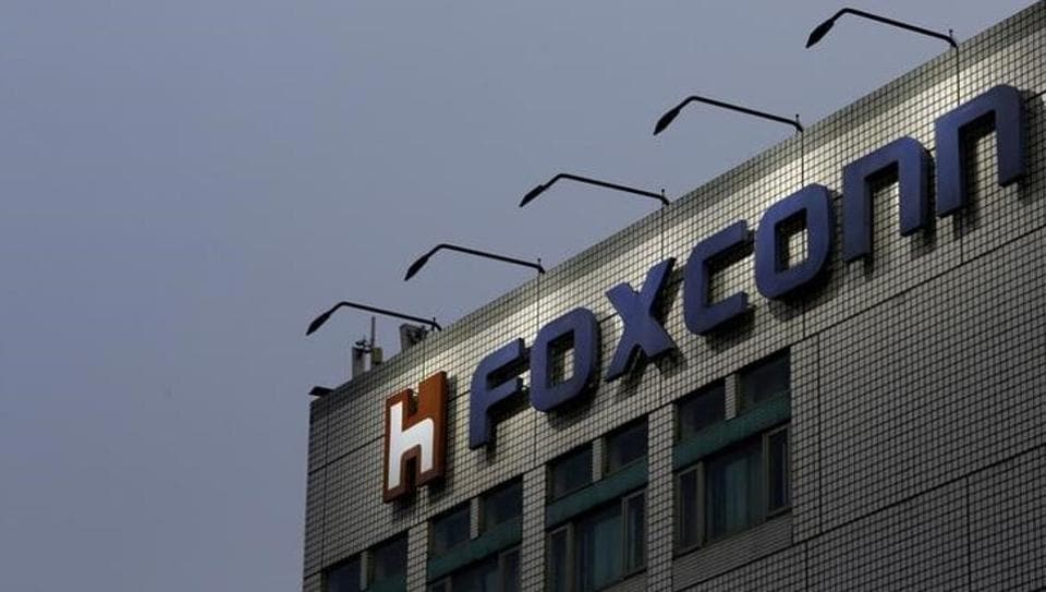 The logo of Foxconn, the trading name of Hon Hai Precision Industry, is seen on top of the company's headquarters in New Taipei City, Taiwan.