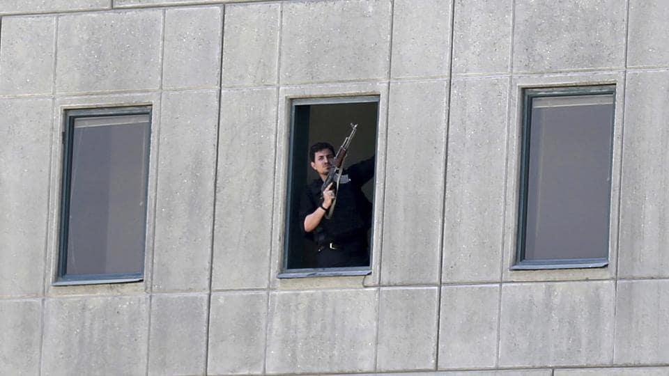 FILE - in this Wednesday, June 7, 2017 file photo, an armed man stands in a window of the parliament building during an attack by militants in Tehran, Iran. Its strongholds in Iraq and Syria slipping from its grasp, the Islamic State group threatened to make this year's Ramadan a bloody one at home and abroad. With attacks in Egypt, Britain and Iran among others and a land-grab in the Philippines, the group is trying to divert attention from its losses and win over supporters around the world in the twisted competition for jihadi recruits. (Fars News Agency, Omid Vahabzadeh via AP, File)