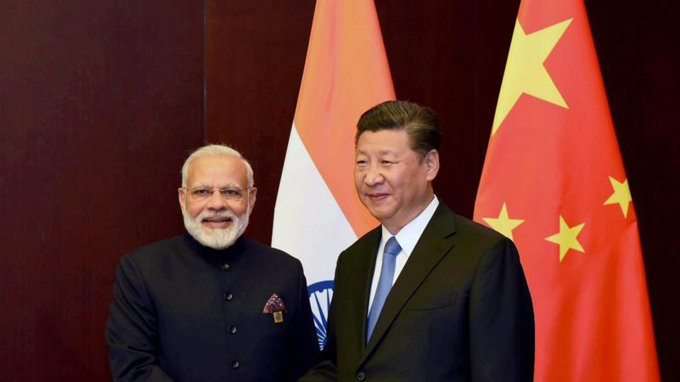 Prime Minister Narendra Modi and Chinese President Xi Jinping on the sidelines of the SCO Summit in Astana, Kazakhstan,  June 9