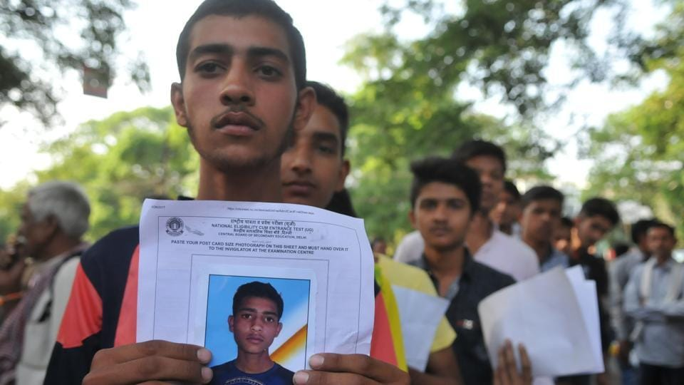 Medical aspirants line up outside an exam centre of NEET 2017 in Bhopal, on Sunday, May 7, 2017.