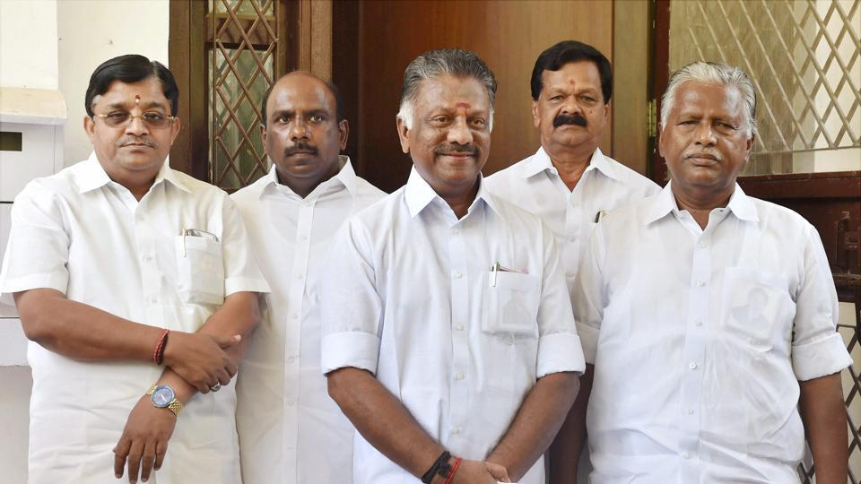 Former Tamil Nadu Chief Minister O Panneerselvam (centre) with former AIADMK minister KP Munusamy (R) and AIADMK Rajya Sabha MP V Maitreyan (L) when they approached the Election Commission urging it to restrain the VK Sasikala faction from using the AIADMK office, in New Delhi on May 19, 2017.