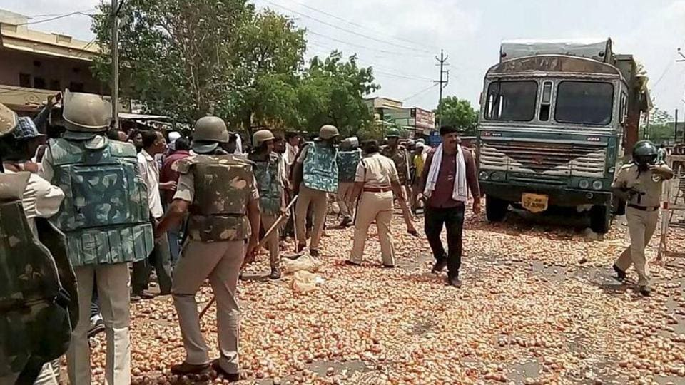 Farmers throw onions and other vegetables on the road during their protest in Shajapur of Madhya Pradesh on Thursday.