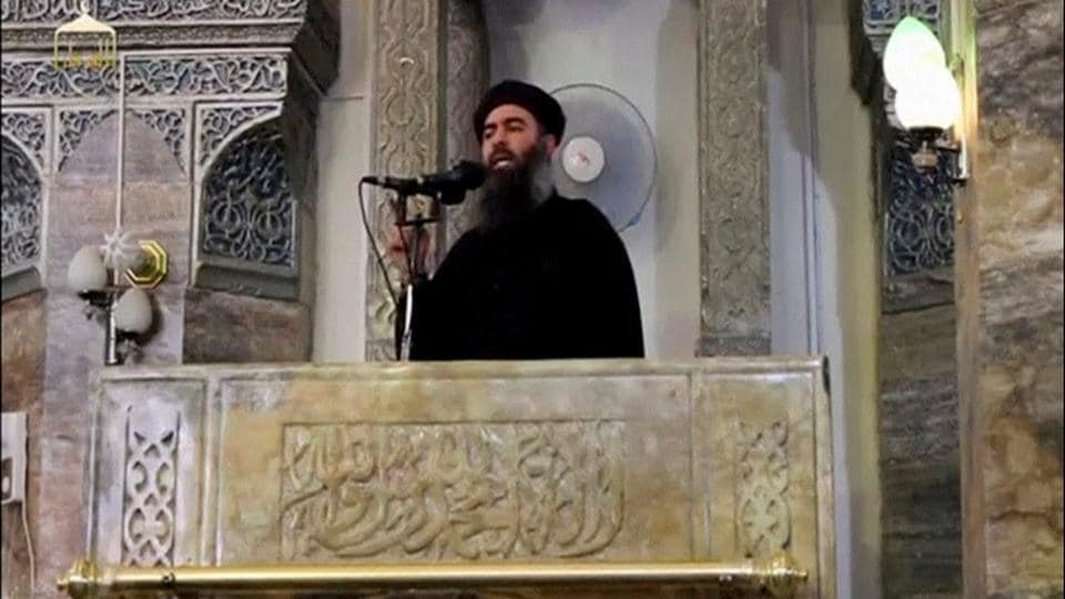 File photo of the reclusive leader of the Islamic State, Abu Bakr al-Baghdadi, making what would have been his first public appearance at a mosque in the Iraqi city of Mosul, according to a video posted on the internet in July 2014.