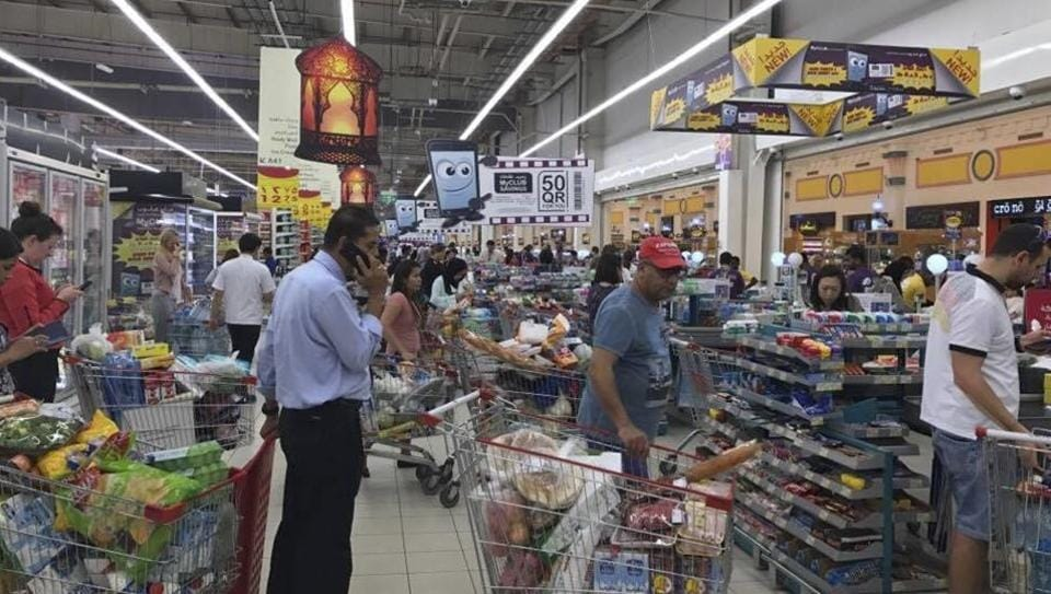 In this Monday, June 5, 2017 file photo, provided by Doha News, shoppers stock up on supplies at a supermarket in Doha, Qatar.