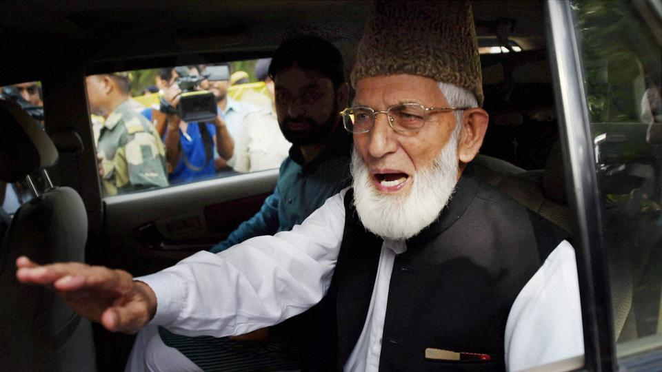 Separatist leader Syed Ali Shah Geelani leaves after a meeting at Pakistan High Commission in New Delhi.