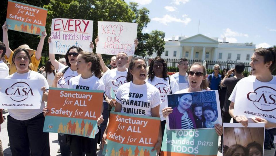 Demonstrators with the organisation CASA protest US President Donald Trump's immigration and deportation policies during a rally outside the White House in Washington, DC, June 1, 2017.