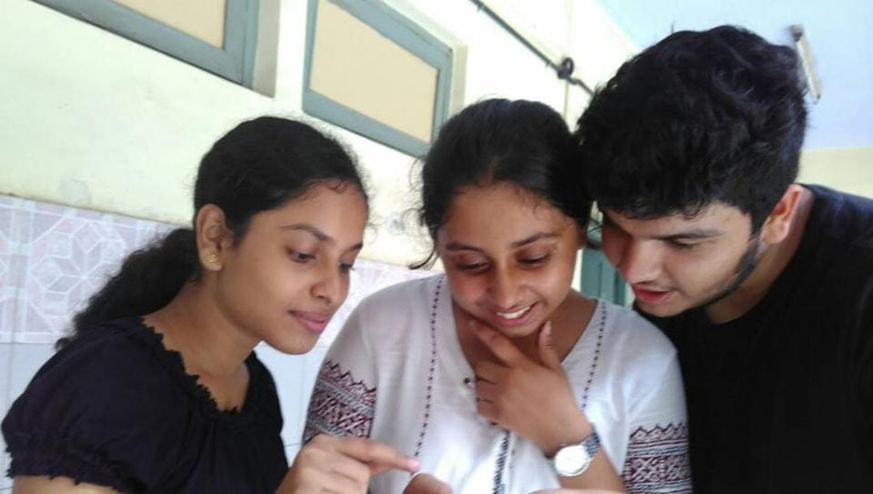 Students in a Vashi school check their exam results