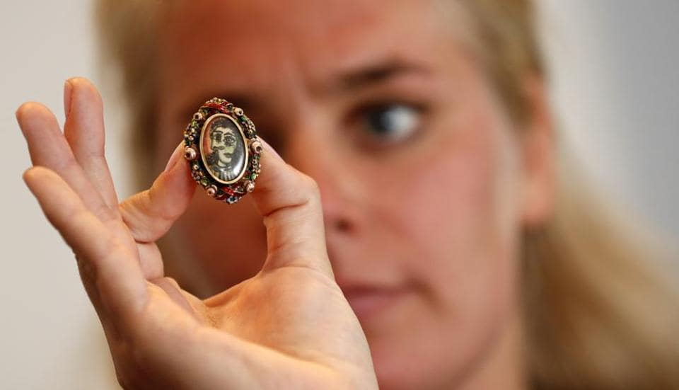 A model poses with an oval-shaped ring designed by Pablo Picasso.