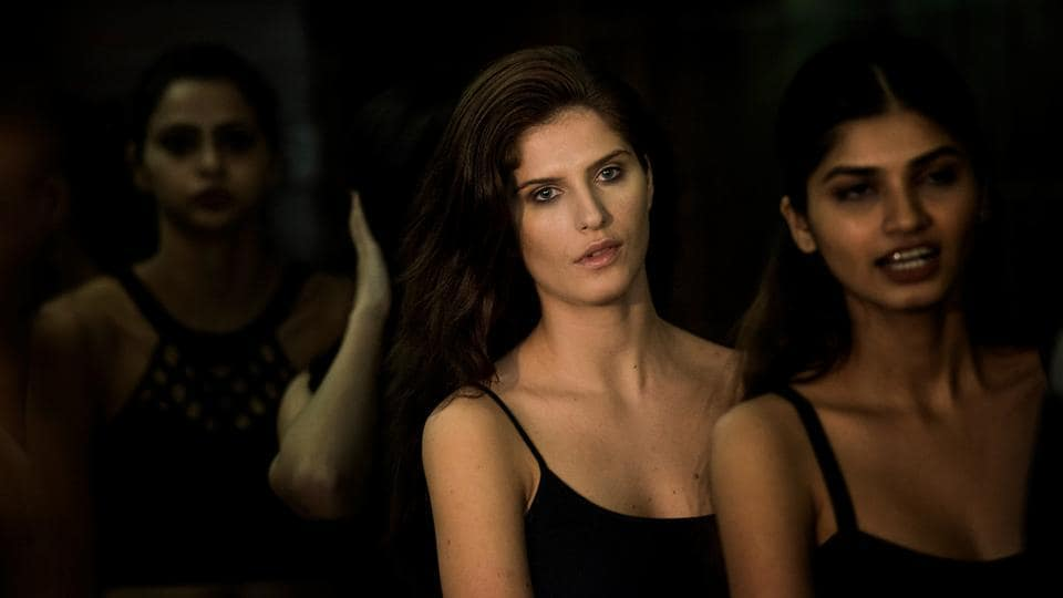 Models  backstage wait  for their turn to be on the ramp. (Aalok Soni/HT Photo)