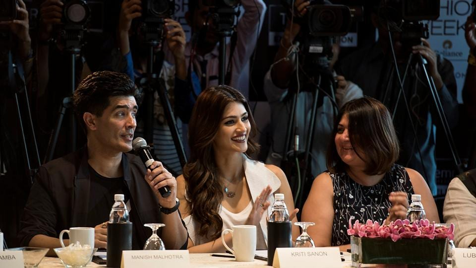 Jury members  Manish Malhotra and Kriti Sanon share a light moment during the event.  (Aalok Soni/HT Photo)