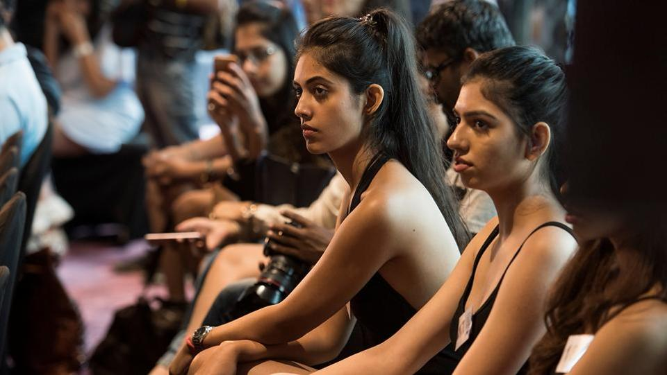Models watch as other participants walk the ramp.  (Aalok Soni/HT Photo)