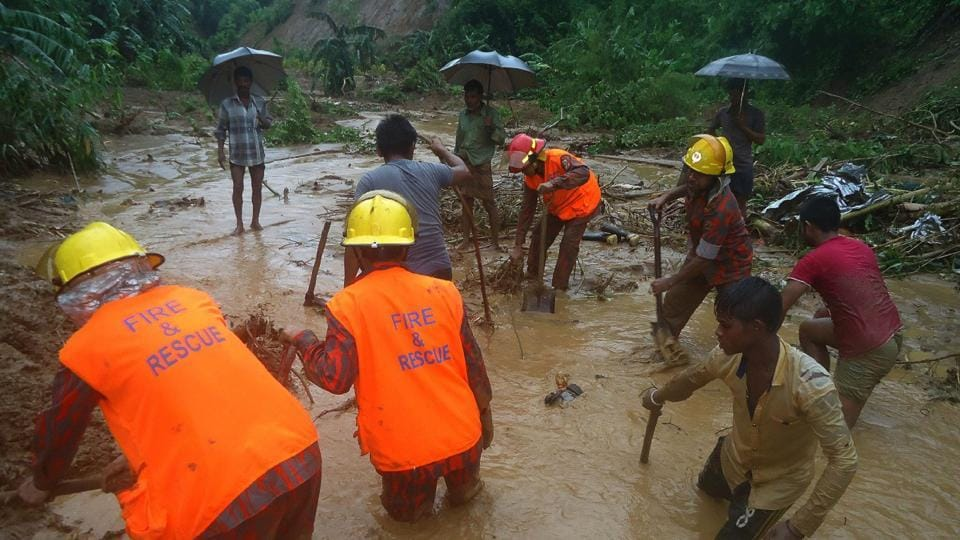Bangladeshi fire fighters and residents search for bodies after a landslide in Bandarban on Tuesday.