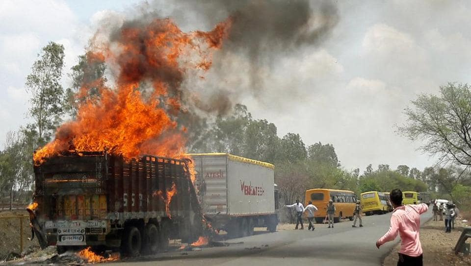A truck burns during a farmers protest on a highway near Bhopal in Madhya Pradesh.