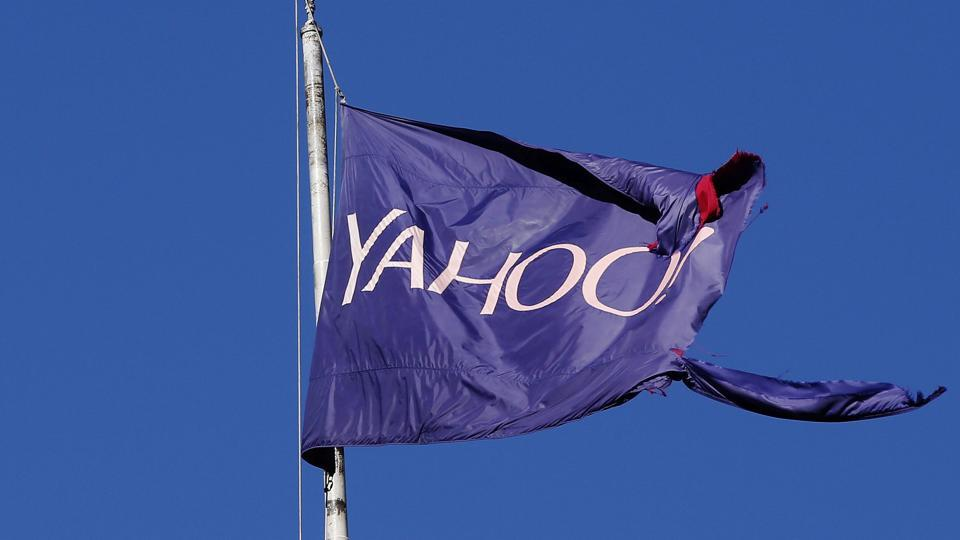 A tattered flag bearing the Yahoo company logo flies above a building in New York.
