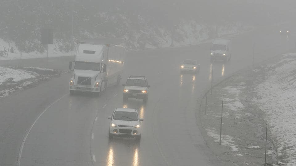 Vehicles drive through fog and and a light rain on eastbound Highway 8, near Soda Springs, Calif.  In late winter and early spring, the snowpack was as large as it had been in decades. (Rich Pedroncelli / AP)