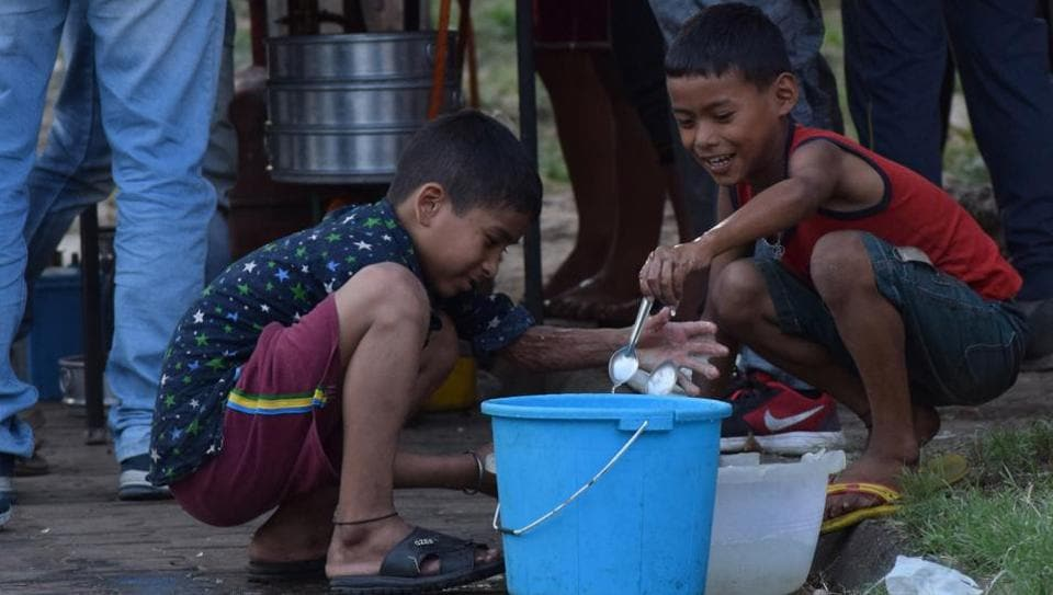 Still willing to grapple with life, children washing plates at a roadside eatery in Chandigarh on Monday.