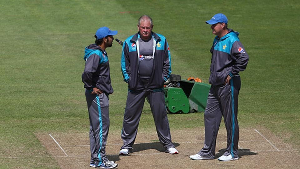 Pakistan cricket team captain Sarfraz Ahmed (L), fielding coach Steve Rixon (C) and head coach Mickey Arthur (R)  inspect the strip during a team training session at the Sophia Gardens cricket ground in Cardiff on Tuesday, a day ahead of their ICC Champions Trophy semifinal match vs England cricket team.