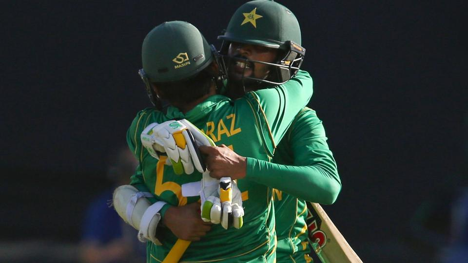 Pakistan cricket team's Mohammad Amir (R) celebrates with skipper Sarfraz Ahmed after their victory in the ICC Champions Trophy 2017 match against Sri Lanka cricket team in Cardiff on Monday.