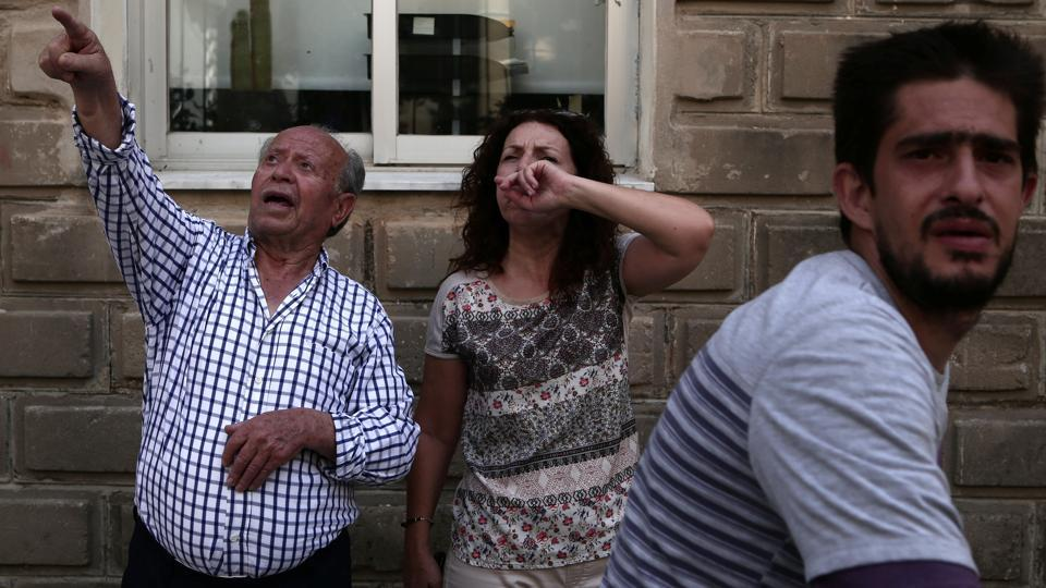 Lesbos Mayor Spyros Galinos and the fire service said the woman was found dead in the southern village of Vrisa that was worst-hit by the quake, which had its epicentre under the sea. (Elias Marcou / REUTERS)