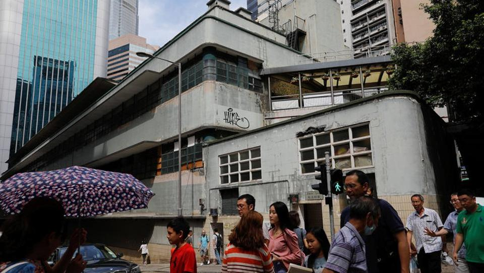 People walk past the abandoned historic Central Market, which was built in the 1930's during the colonial era, in Hong Kong. Protests in 2007 against the tearing down of Victoria Harbour's Queen's Pier, which for almost half a century marked the ceremonial arrivals of British governors and royals including Queen Elizabeth, is often cited as a starting point for street activism bent on preserving Hong Kong's culture. (REUTERS)